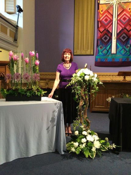 Jean McClure with 2 of her arrangements